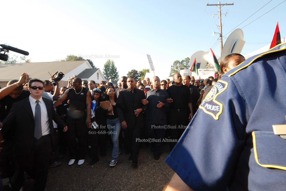 "Sep 20, 2007 - Jena, LA, USA - Louisiana State police walk hand in hand in front of Rev. AL SHARPTON, MICHALE BAISDEN and Michael Bell's mother. The plight of the ""Jena Six"", a group of black teenagers who were initially charged with attempted murder after beating a white classmate, has provoked one of the biggest civil rights demonstrations in the US in recent years. Protesters converged on the small Louisiana town of Jena to demonstrate against what they said was a double standard of prosecution for blacks and whites. They came in their thousands, protesters from across the United States carrying banners and signs that declared ""Free the Jena six"" and ""Enough is enough"". (Credit Image: © Suzi Altman/ZUMA Press"
