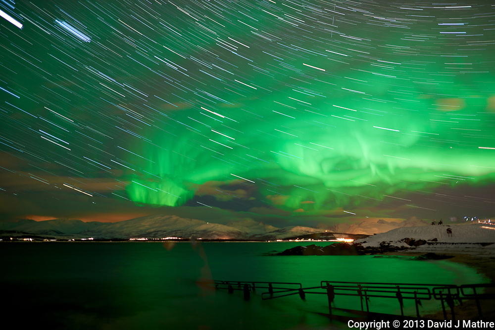 Northern Lights and Star Trails from Telegrafbukta Beach in Tromsø Norway. Composite of 68 images taken with a Nikon D800 camera and 24 mm f/1.4 lens (ISO 800, 24 mm, f/2, 8 sec). Raw image processed with Capture One Pro and PhotoShop CC (statistics, maximum)