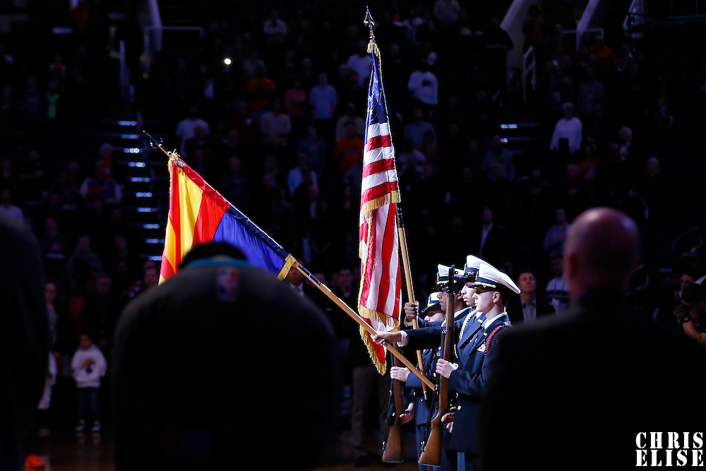 06 January 2016: Soldiers hold the US flag and the Arizona flag during the National Anthem prior to the Phoenix Suns 111-102 victory over the Charlotte Hornets, at the Talking Stick Resort Arena, Phoenix, Arizone, USA.