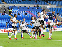 Football - 2019 / 2020 Championship - Play-off semi-final - 1st leg - Cardiff City vs Fulham<br /> <br /> Cyrus Christie of Fulham defends  in the air <br /> in a match played with no crowd due to Covid 19 coronavirus emergency regulations, in an almost empty ground, at the Cardiff City Stadium<br /> <br /> COLORSPORT/WINSTON BYNORTH