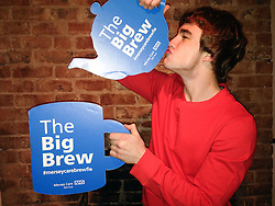 "© Licensed to London News Pictures . 19/01/2015 . Liverpool , UK . Nico Mirallegro from Hollyoaks and My Mad Fat Diary . Celebrities pose with "" Big Brew "" placards in support of mental health awareness as today (19th January 2015) marks "" Blue Monday "" , the day regarded by many as the most depressing in the year . Campaigners are urging the public to show support by tweeting sefies with their favourite brew and the hashtag "" #brewfie "" . In London , Deputy Prime Minister Nick Clegg , is announcing his campaign to improve mental health awareness , reduce stigma and promote a "" zero ambition "" target for suicide . Photo credit : Joel Goodman/LNP"