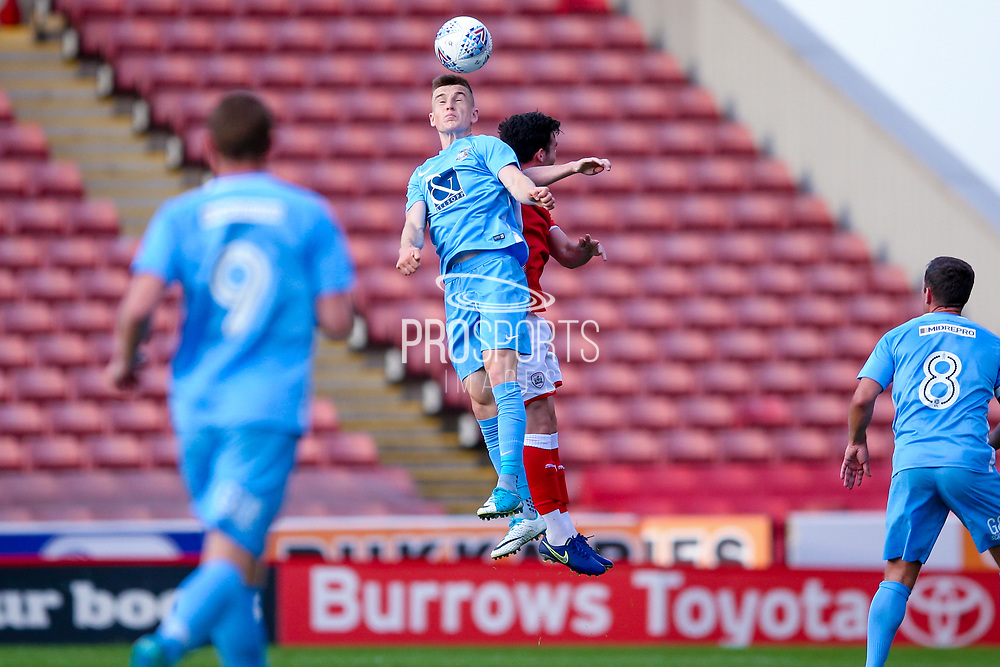 Coventry City defender Darragh Leahy (3) meets the ball with his head during the Pre-Season Friendly match between Barnsley and Coventry City at Oakwell, Barnsley, England on 18 July 2017. Photo by Simon Davies.