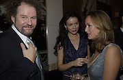 Mike Figgis, Saffron Burrows and Lucy Yeomans. David Bailey dinner hosted by Lucy Yeomans at Gordon Ramsay at Claridge's. 12 November 2001. © Copyright Photograph by Dafydd Jones 66 Stockwell Park Rd. London SW9 0DA Tel 020 7733 0108 www.dafjones.com