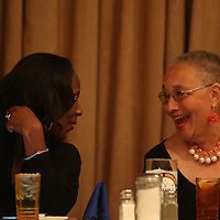 Recipient of the Alice I. Little Humanitarian Award, Honorable Nettie Davis, shares a laugh with guest speaker, Colonel Chris Gillard's wife Karla, Saturday evening at the Mr. Walter Standfield Freedom Fund Banquet