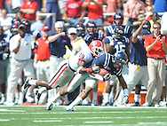 Ole Miss' Ja-Mes Logan (85) is tackled by Georgia cornerback Sanders Commings (19) at Vaught-Hemingway Stadium in Oxford, Miss. on Saturday, September 24, 2011. The play, a touchdown, was called back due to penalty. Georgia won 27-13.