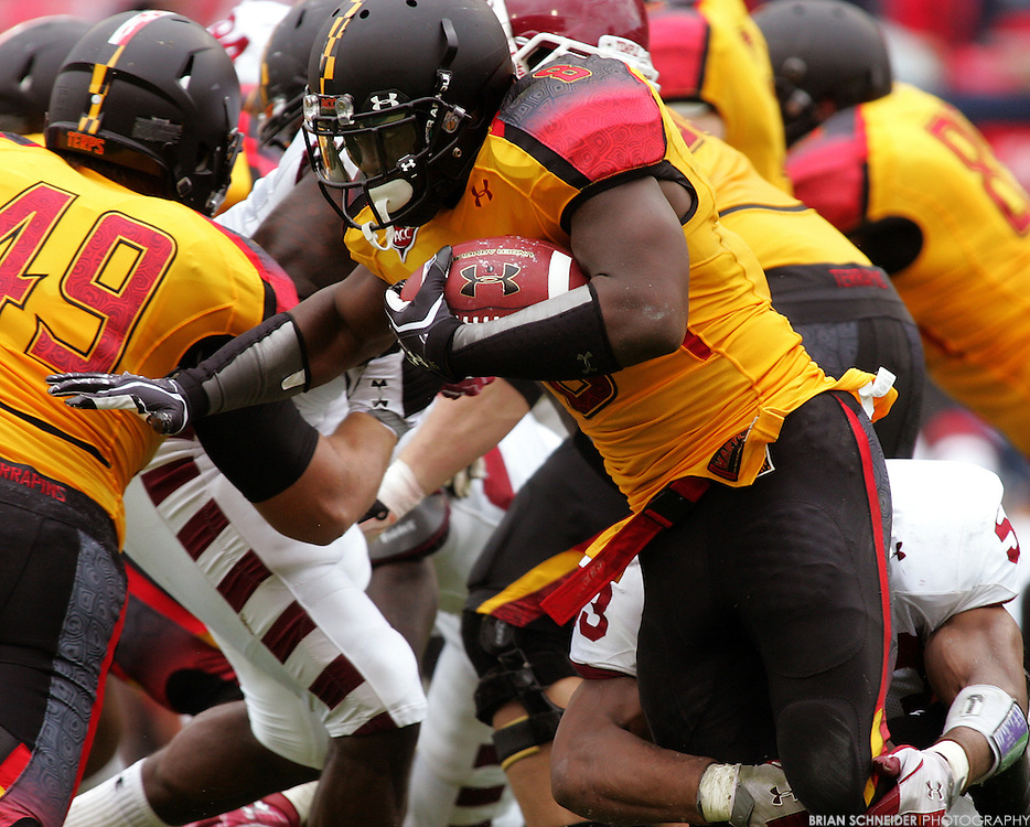 September 24, 2011; College Park, MD, USA; Maryland Terrapins running back Davin Meggett (8) on a rushing play against the Temple Owls during second half at Byrd Stadium in College Park, Maryland. Brian Schneider-www.ebrianschneider.com