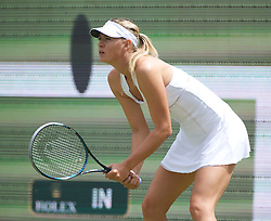 LONDON, ENGLAND - Friday, June 24, 2011: Maria Sharapova (RUS) in front of a large screen broadcast of Hawk-Eye during the Ladies' Singles 2nd Round match on day five of the Wimbledon Lawn Tennis Championships at the All England Lawn Tennis and Croquet Club. (Pic by David Rawcliffe/Propaganda)