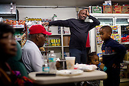 "Claudius ""Lucky"" Taylor Jr. (center) looks over four generations of his family at Taylor's Grocery at 610 S.E. 10th St. in Stuart on Jan. 12, 2016, including (from left) his parents Ruby and Claudius Taylor Sr., his 14-month-old grandson Isaac Taylor and 6-year-old son Claudius Taylor III. Twelve years ago, Lucky took over managing the East Stuart rental properties and grocery store, which his parents opened in 1972. Shootings at one of the rentals on his property in 2015 put Lucky, a veteran and former military security advisor, on alert. (XAVIER MASCAREÑAS/TREASURE COAST NEWSPAPERS)"