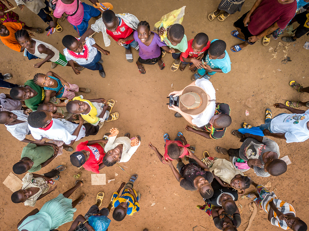 Aerial image of children pumping water at a school in Ganta, Liberia
