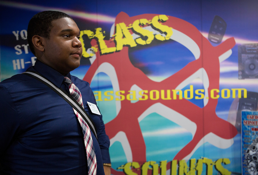 Skyler Palmer, a participant in Ohio University's Junior Executive Business Program, listens to a presentation by Aaron Thomas, owner of Class A Sounds, at the store on July 14, 2014. Photo by Lauren Pond