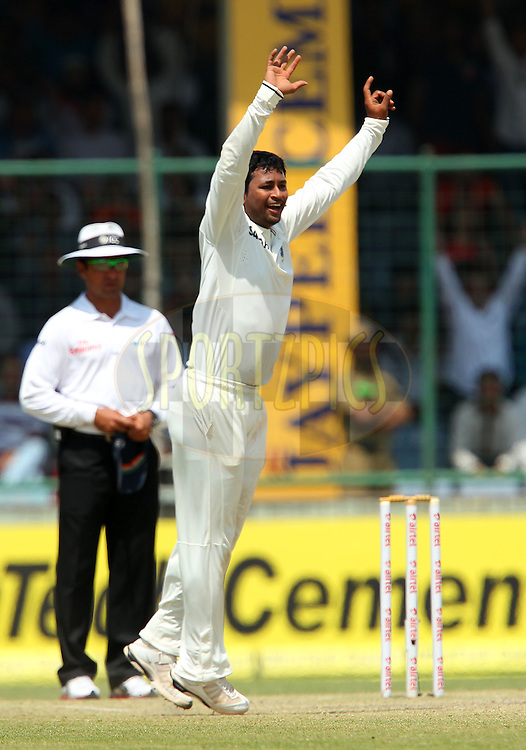 Pragyan Ojha of India celebrates the wicket of Matthew Wade of Australia during day 3 of the 4th Test Match between India and Australia held at the Feroz Shah Kotla stadium in Delhi on the 24th March 2013..Photo by Ron Gaunt/BCCI/SPORTZPICS ..Use of this image is subject to the terms and conditions as outlined by the BCCI. These terms can be found by following this link:..http://www.sportzpics.co.za/image/I0000SoRagM2cIEc