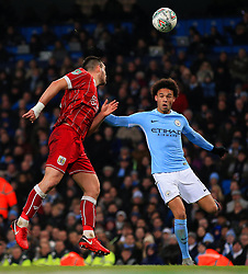 Bailey Wright of Bristol City clears a header above Leroy Sane of Manchester City - Mandatory by-line: Matt McNulty/JMP - 09/01/2018 - FOOTBALL - Etihad Stadium - Manchester, England - Manchester City v Bristol City - Carabao Cup Semi-Final First Leg