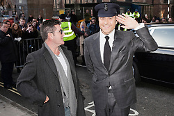 © Licensed to London News Pictures. 11/02/2014. London, UK. Simon Cowell and David Walliams as they attend during Britain's Got Talent 2014 auditions outside the Hammersmith Apollo. Photo credit : Andrea Baldo/LNP