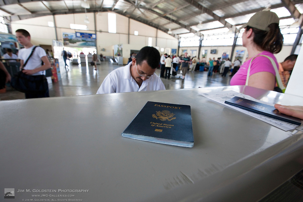 Possports ready to be checked by a Costa Rican Customs Agent at the LIberia Airport in Costa Rica