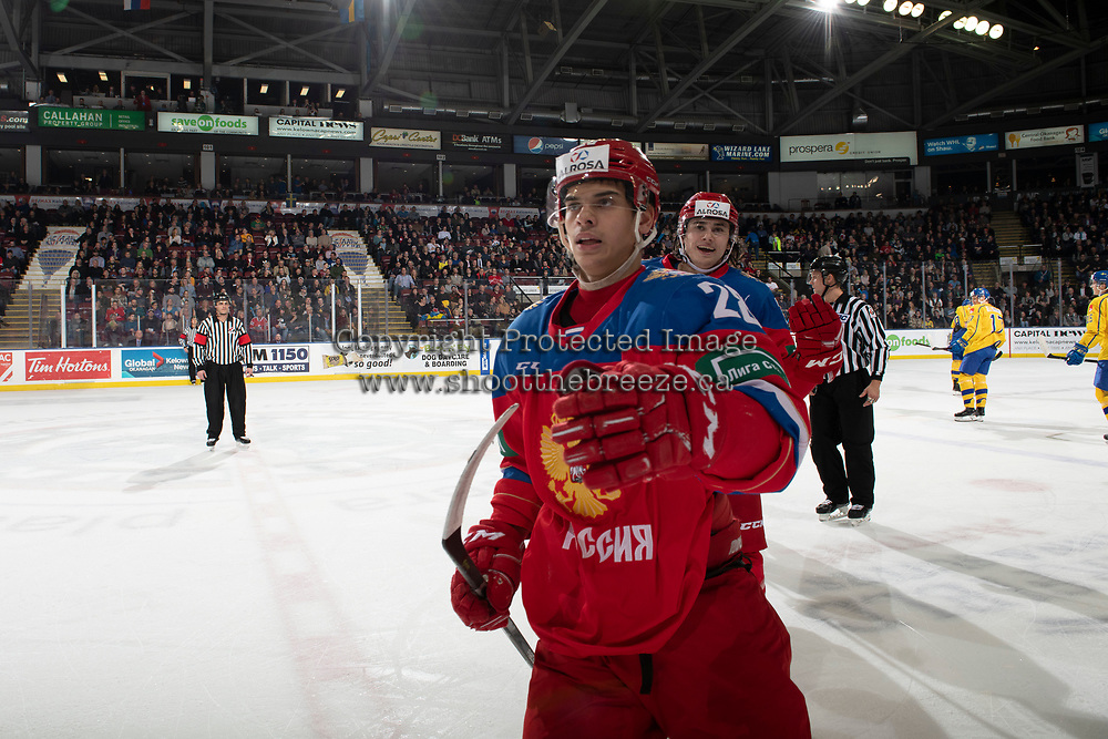 KELOWNA, BC - DECEMBER 18: Grigory Denisenko #28 and Alexander Romanov #26 of Team Russia celebrate a first period goal against the Team Sweden  at Prospera Place on December 18, 2018 in Kelowna, Canada. (Photo by Marissa Baecker/Getty Images)***Local Caption***