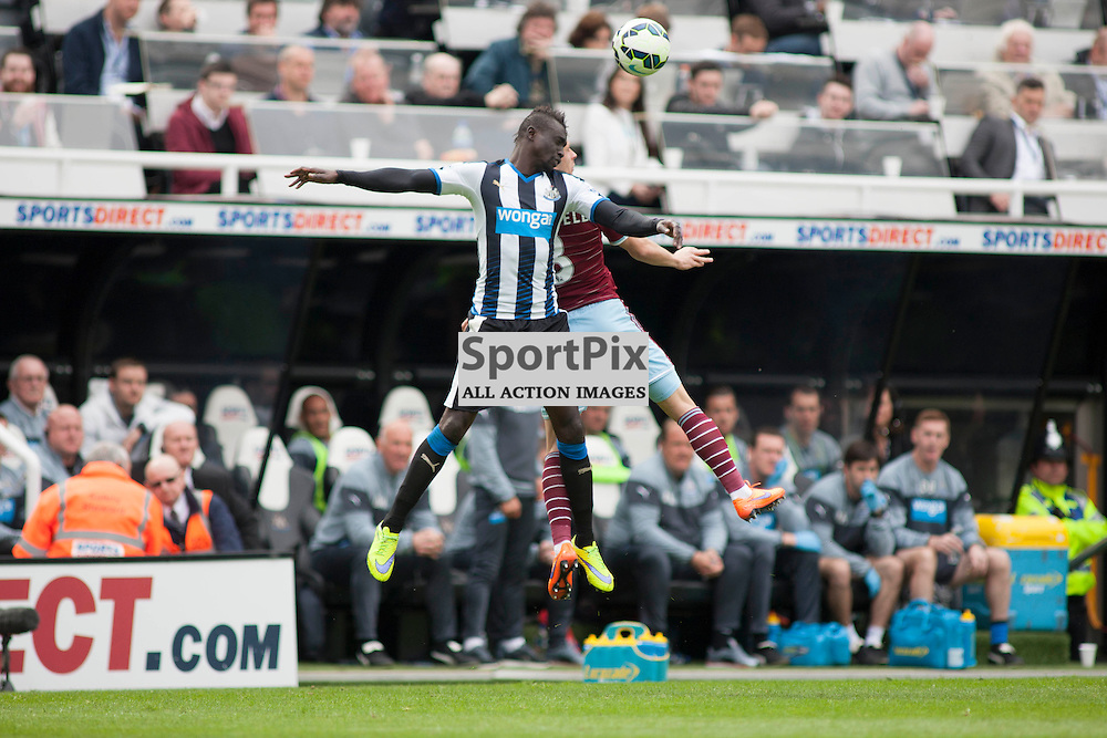 Papiss Cisse and Aaron Creswell go up for a header in the Newcastle v West Ham, Barclays Premiership match at St James&rsquo; Park, Newcastle 24 May 2014<br /><br />(c) Russell G Sneddon / SportPix.org.uk