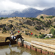 Lisa Milliken riding My Holly in action at the water jump during the Cross Country event at the Wakatipu One Day Horse Trials at the Pony Club grounds,  Queenstown, Otago, New Zealand. 15th January 2012. Photo Tim Clayton