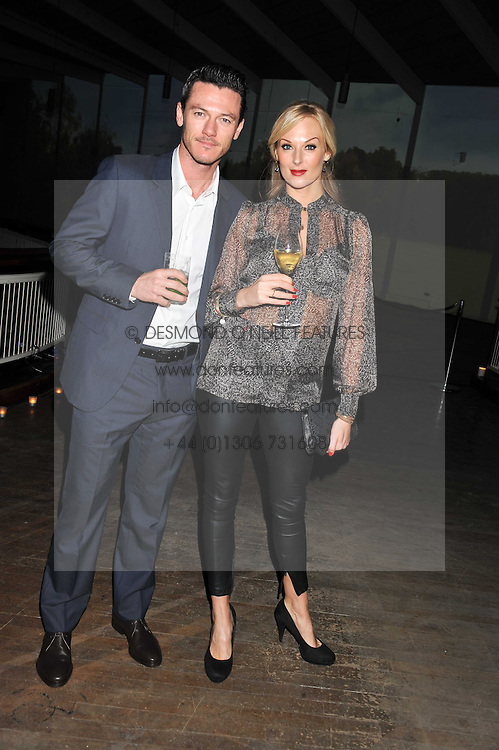 LUKE EVANS and KATHERINE KINGSLEY  at a dinner hosted by Calvin Klein Collection to celebrate the future Home of The Design Museum at The Commonwealth Institute, Kensington, London on 13th October 2011.