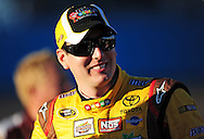 Nov 12, 2010; Avondale, AZ, USA; NASCAR Sprint Cup Series driver Kyle Busch (18) reacts during qualifying for the Kobalt Tool 500 at Phoenix International Raceway. Mandatory Credit: Jennifer Stewart-US PRESSWIRE