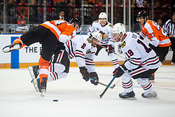 Duncan Keith of Chicago Blackhawks and Sean Couturier of Philadelphia Flyers during NHL game between teams Chicago Blackhawks and Philadelphia Flyers at NHL Global Series in Prague, O2 arena on 4th of October 2019, Prague, Czech Republic. Photo by Grega Valancic / Sportida