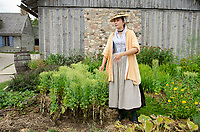 Woman in period dress describing gardens. Colonial Michilimackinac, Mackinaw City Michigan.