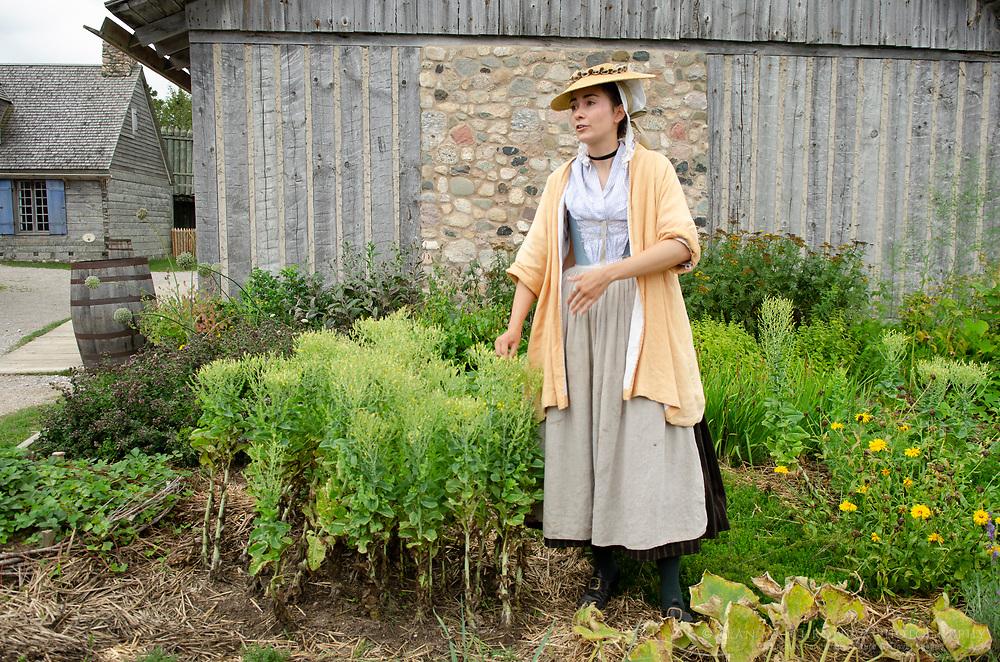 Woman in period dress describing gardens. Colonial Michilimackinac, Mackinaw City Michigan.