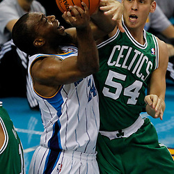 December 28, 2011; New Orleans, LA, USA; New Orleans Hornets power forward Carl Landry (24) is fouled by Boston Celtics center Greg Stiemsma (54) during the second quarter of a game at the New Orleans Arena.   Mandatory Credit: Derick E. Hingle-US PRESSWIRE