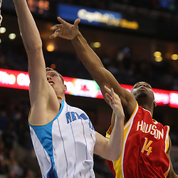 Jan 02, 2010; New Orleans, LA, USA; New Orleans Hornets forward Darius Songaila (9) shoots past Houston Rockets forward Carl Landry (14) during the third quarter at the New Orleans Arena. Mandatory Credit: Derick E. Hingle-US PRESSWIRE