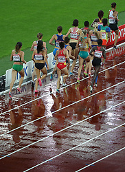 London, August 09 2017 . The athletes are reflected on the rain-soaked track during heat three of the women's 3,000m steeplechase heats on day six of the IAAF London 2017 world Championships at the London Stadium. © Paul Davey.