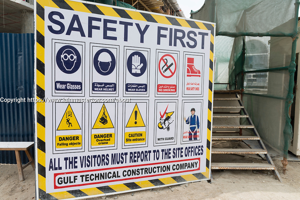 Signboard at construction site in Dubai with safety rules and regulations