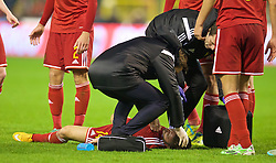 BRUSSELS, BELGIUM - Sunday, November 16, 2014: Belgium's Dries Mertens is knocked unconscious after challenging for a heading during the UEFA Euro 2016 Qualifying Group B game against Wales at the King Baudouin [Heysel] Stadium. (Pic by David Rawcliffe/Propaganda)