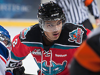 KELOWNA, CANADA - NOVEMBER 23:  Tyrell Goulbourne #12 of the Kelowna Rockets faces off against the Regina Pats at the Kelowna Rockets on November 23, 2012 at Prospera Place in Kelowna, British Columbia, Canada (Photo by Marissa Baecker/Shoot the Breeze) *** Local Caption *** Tyrell Goulbourne;