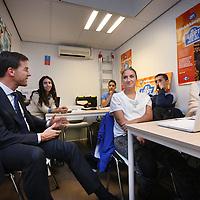 Nederland, Amsterdam , 30-10-2014.<br /> Bedrijfsbezoek van minister-president Mark Rutte op uitnodiging van Ahold/Albert Heijn aan Albert Heijn filiaal in de Molukkenstraat in Amsterdam Oost.<br /> Op de foto: Mark rutte in gesprek met scholieren en medewerkers van AH in de zg studieruimte, een plek waar de jongeren hun huiswerk kunnen doen als er thuis geen plek voor is.<br /> <br /> <br /> Foto:Jean-Pierre Jans/ANPinOpdracht
