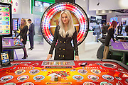 UNITED KINGDOM, London: 02 February 2016 Promotion girl Marlena Lejk stands in front of a spinning wheel at this years ICE Totally Gaming Convention held at the Excel Arena, East London. The three day event is the world's premier international expo for gaming and gambling professionals. Rick Findler / Story Picture Agency