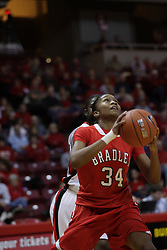30 December 2010: Raisa Taylor eyes the bucket after getting past Candace Sykes during an NCAA Womens basketball game between the Bradley Braves and the Illinois State Redbirds at Redbird Arena in Normal Illinois.