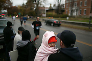 Emma Miller, 6 months, of Avon, takes in the East Ave Grocery Run in Rochester on Saturday, November 1, 2014.