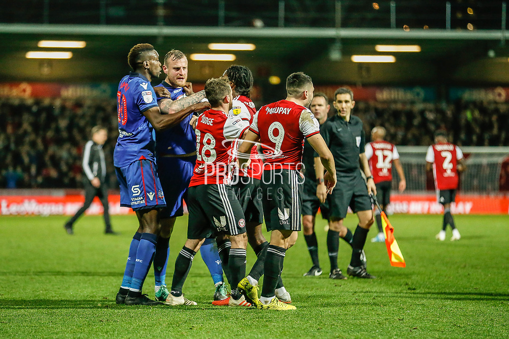 Brentford midfielder Alan Judge (18) clashed with Bolton Wanderers midfielder Gary O'Neil (19), a challenge that sparked conflict between the payers of both sides and a huge reaction from the fans, during the EFL Sky Bet Championship match between Brentford and Bolton Wanderers at Griffin Park, London, England on 22 December 2018.