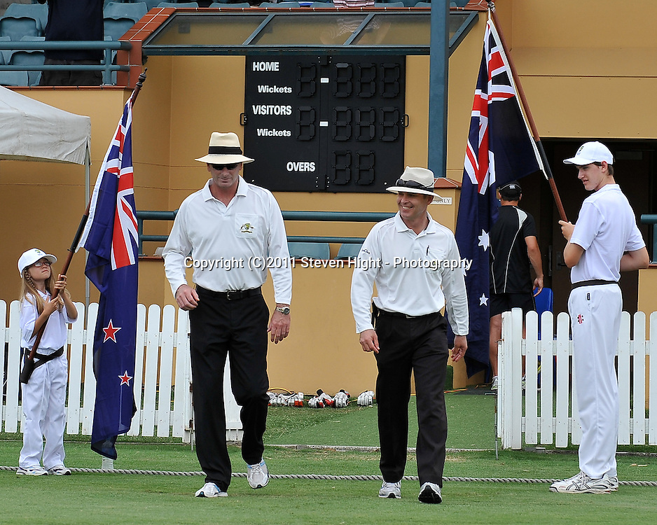 Umpires Paul Rieffel and Simon Fry walk back onto Allan Border Field after the lunch break during action from Day 3 of the Tour match between Australia A and New Zealand played at Allan Border Field from 24th - 27th November 2011~ Photo Credit Required : Steven Hight (AURA Images) ~ Editorial Use only in accordance with CA Terms & Conditions (2011-12)