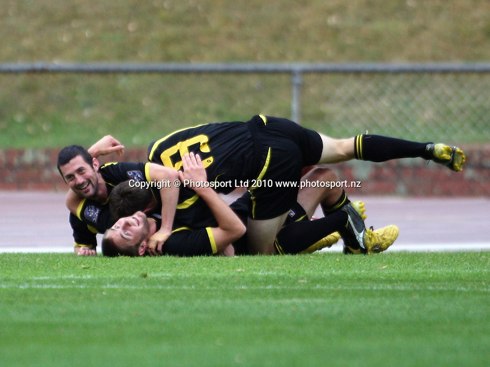 Wellington's Bryan Little and Greg Draper congratulate Andy Barron on his goal, which took Wellington 2-0 up.<br /> NZFC soccer  - Team Wellington v Waitakere United at Newtown Park, Wellington. Sunday, 4 April 2010. Photo: Dave Lintott/PHOTOSPORT