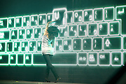 Female Contemporary Dancer performs in front of a computer keyboard backdrop
