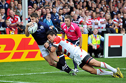 Tommy Seymour of Scotland is tackled into touch by Ayumu Goromaru of Japan - Mandatory byline: Patrick Khachfe/JMP - 07966 386802 - 23/09/2015 - RUGBY UNION - Kingsholm Stadium - Gloucester, England - Scotland v Japan - Rugby World Cup 2015 Pool B.