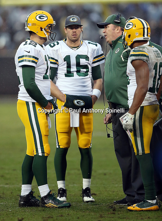 Green Bay Packers quarterback Scott Tolzien (16) looks on as Green Bay Packers quarterback Aaron Rodgers (12) has a sideline conversation with Green Bay Packers head coach Mike McCarthy during the 2015 week 15 regular season NFL football game against the Oakland Raiders on Sunday, Dec. 20, 2015 in Oakland, Calif. The Packers won the game 30-20. (©Paul Anthony Spinelli)