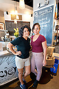 Veronica Canales (left) and Bibiana Canales (right) pose for a photo inside Fair Trade Cafe in downtown Phoenix on August 16, 2016.