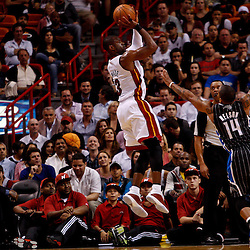 March 3, 2011; Miami, FL, USA; Miami Heat shooting guard Dwyane Wade (3) shoots over Orlando Magic point guard Jameer Nelson (14) during the first half at the American Airlines Arena. The Magic defeated the Heat 99-96.    Mandatory Credit: Derick E. Hingle