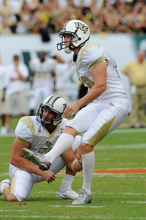 October 11, 2008 - Miami Gardens, FL<br /> <br /> University of Central Florida kicker Daren Daly kicks an extra point during the Knights 20-14 defeat to the Miami Hurricanes at Dolphin Stadium in Miami Gardens, Florida.<br /> <br /> JC Ridley/CSM