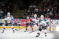 KELOWNA, CANADA - MARCH 23: Brian Williams #26 of the Tri-City Americans looks for the pass amid Madison Bowey #4, Jordon Cooke #30 and Joe Gatenby #28 of the Kelowna Rockets on March 23, 2014 at Prospera Place in Kelowna, British Columbia, Canada.   (Photo by Marissa Baecker/Shoot the Breeze)  *** Local Caption *** Brian Williams; Madison Bowey; Joe Gatenby; Jordon Cooke;