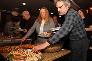 (from right) John & Jeanette Nagle get started in the buffet line as Riverside Area Chamber of Commerce hosts an International Night featuring Indian and American food at the Filling Station Sports Bar & Grill in Riverside, Monday, March 26, 2012.  Owner Doctor Suresh Gupta prepared Indian cuisine including Bean Sprout Cucumber Salad, Butter Chicken, Samosas, Rice/Naan Bread and Veggie Khorma.