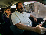Rabbi Mordechai Weiss drives his daughter, Chana, 6, to school inside their settlement in Mitzpeh Yericho, The West Bank.