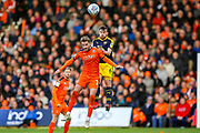 Luton Town midfielder Andrew Shinnie (11) and Oxford United midfielder Jamie Hanson (6) clash in the air during the EFL Sky Bet League 1 match between Luton Town and Oxford United at Kenilworth Road, Luton, England on 4 May 2019.