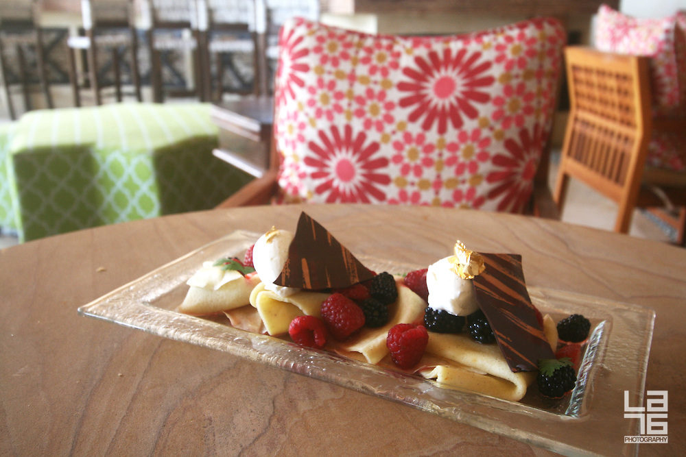 """Light and refreshing dessert called """"Warm Crepes 'a la Plancha' with Wild Berries and Papantla Vanilla Cream"""". The dessert is served at El Farallón, a Cliffside Seafood Grill at Capella Pedregal Hotel & Resort. Prepared by Capella Pedregal's Executive Chef Marco Bustamante."""